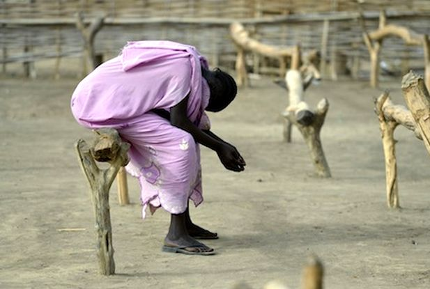 Woman prays while displaced by conflict in contested border region of Sudan